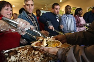 Christian Groups Feed Homeless On Thanksgiving
