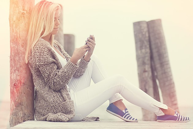 Beauty Young Girl Texting Message on Phone